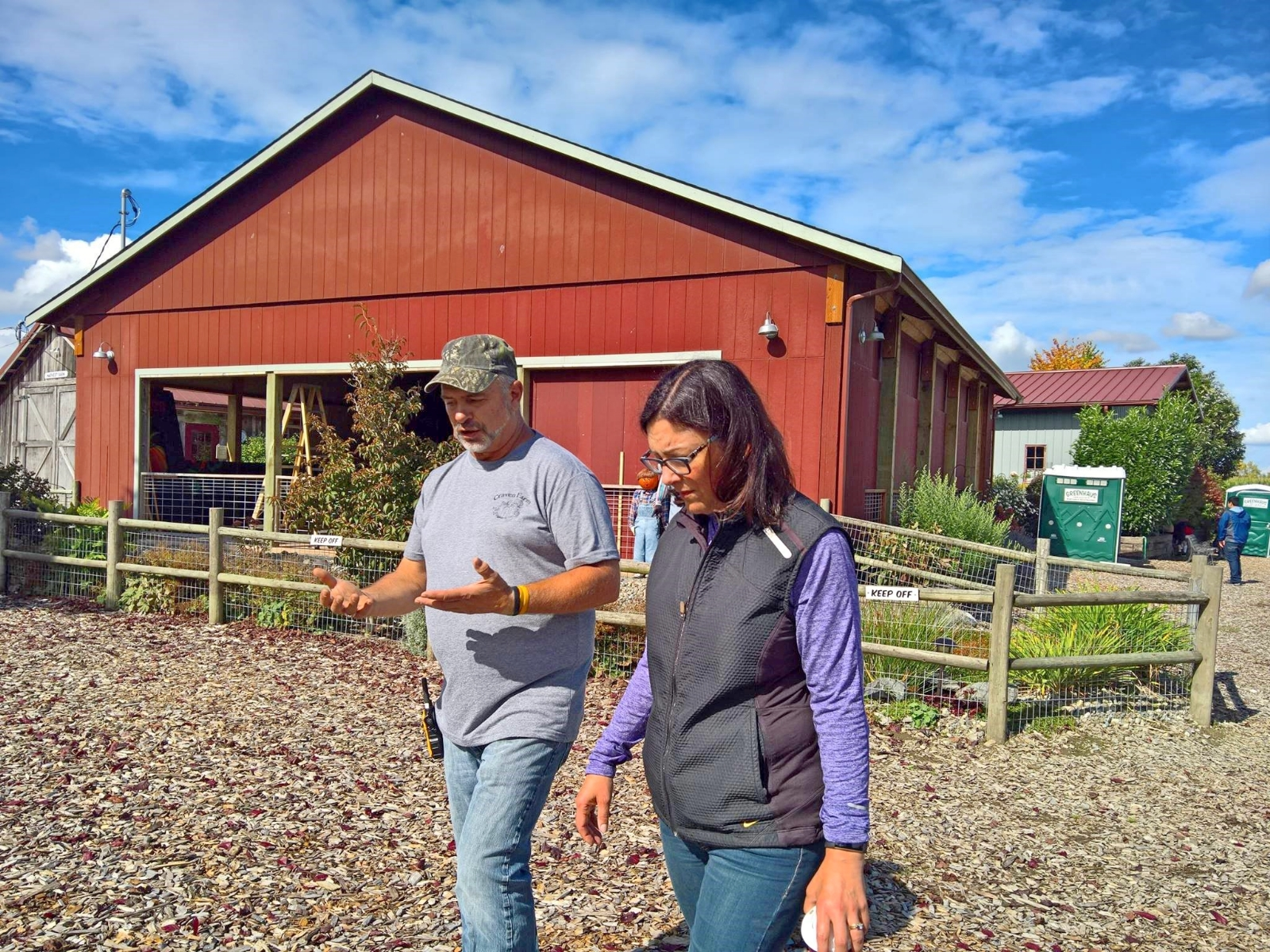 Rep. Suzan DelBene walking through a farm