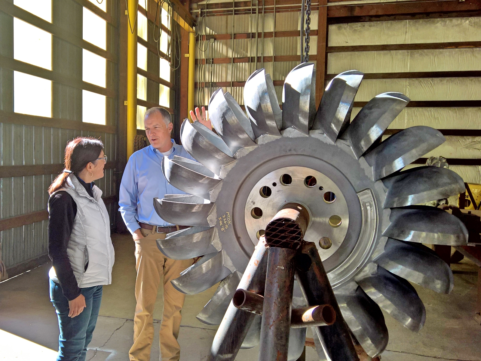 Congresswoman Suzan DelBene next to a wind turbine